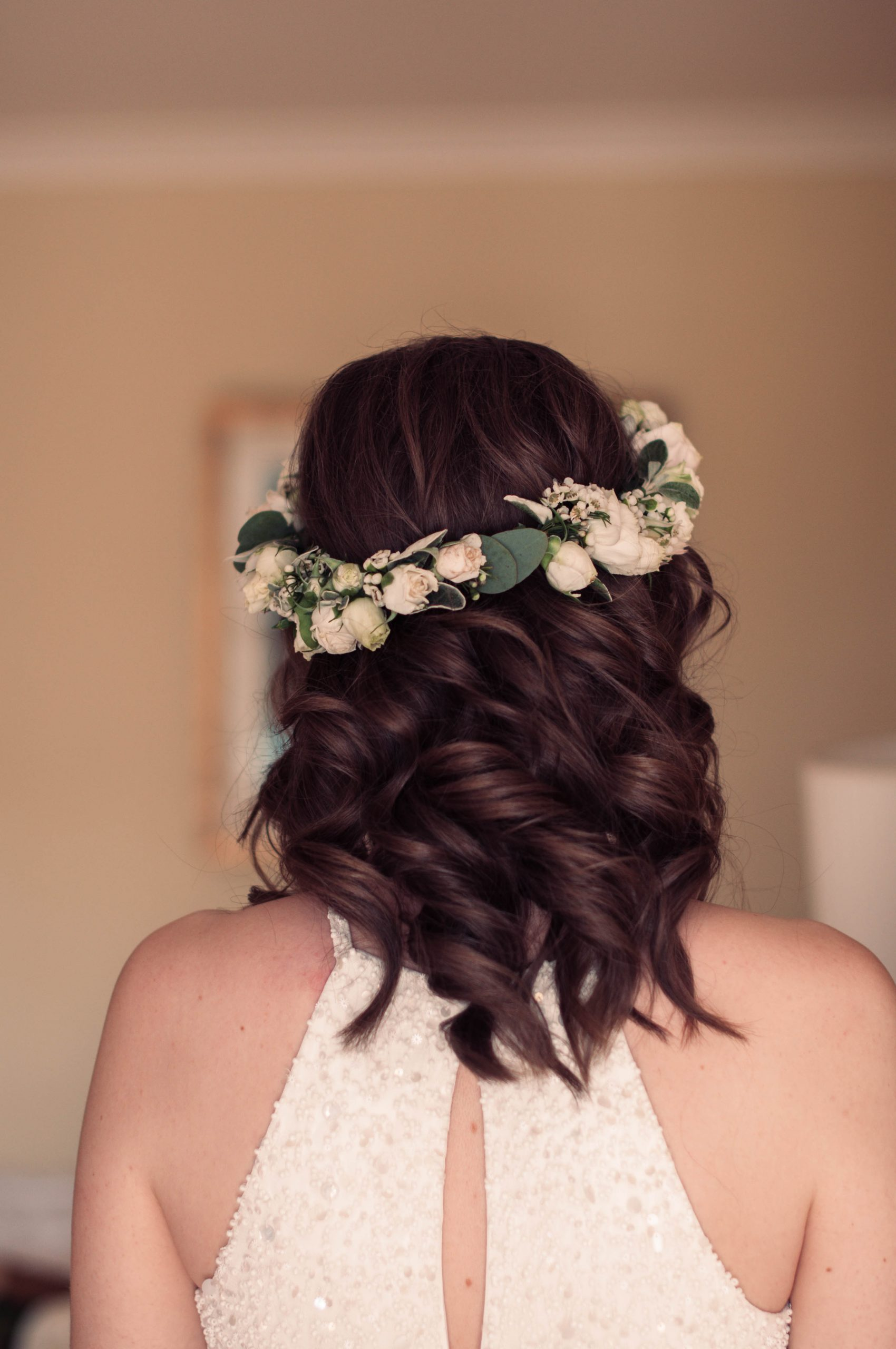Delightful curls with a flower crown